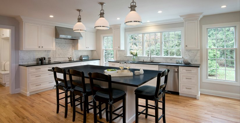 White Grabill cabinets and honed black absolute counters in Clark Construction kitchen.