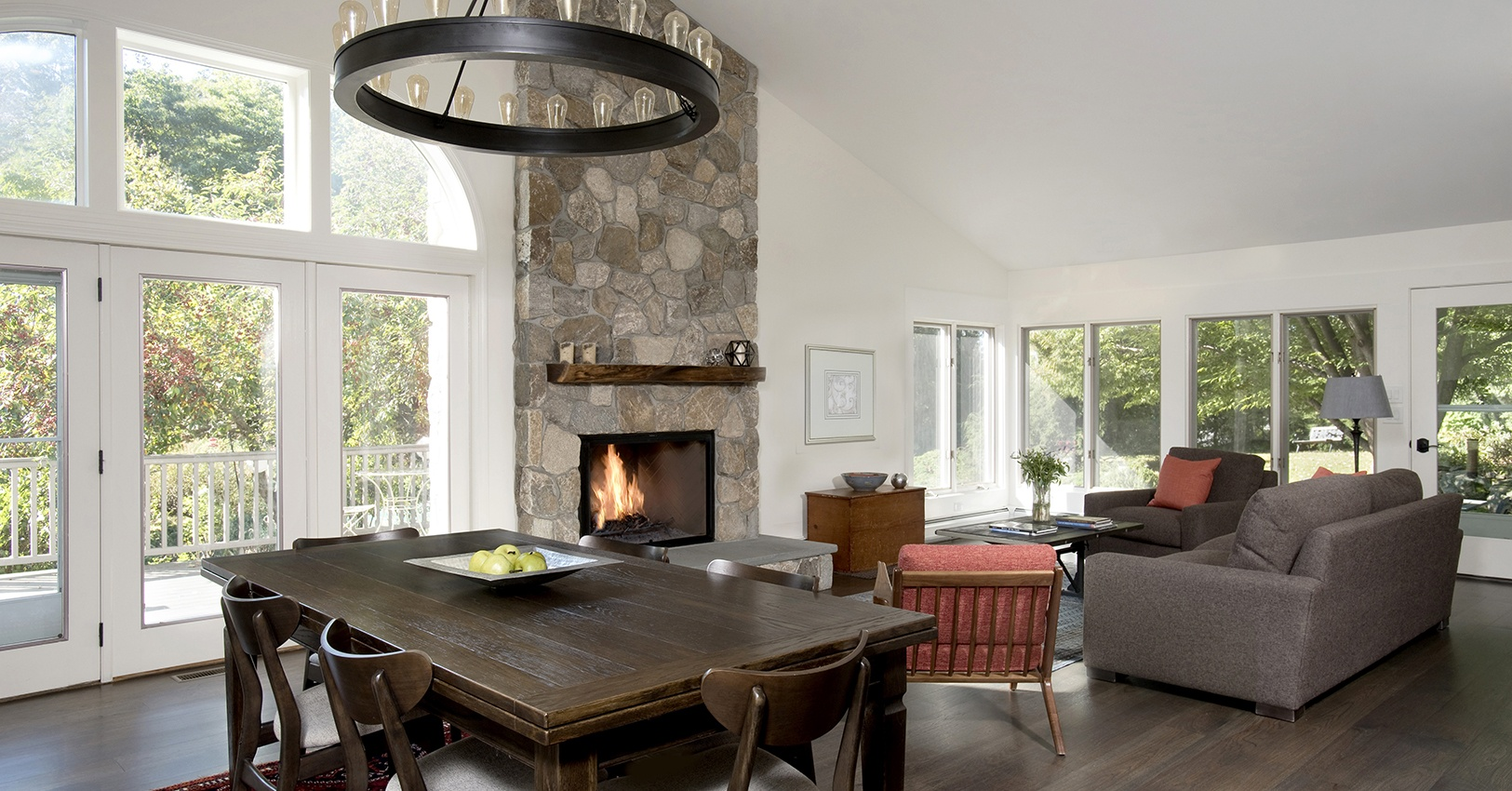 Ridgefield home makeover by Clark Construction with great room and sunroom conversion