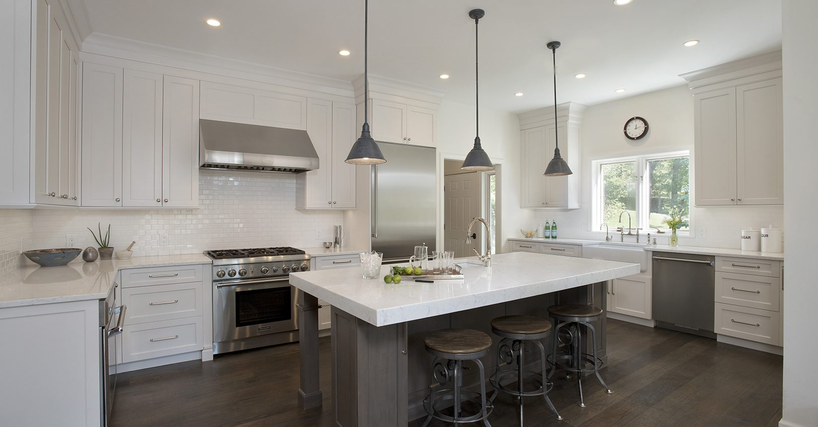 Grabill kitchen cabinetry in white pepper with special finish on island cabinets