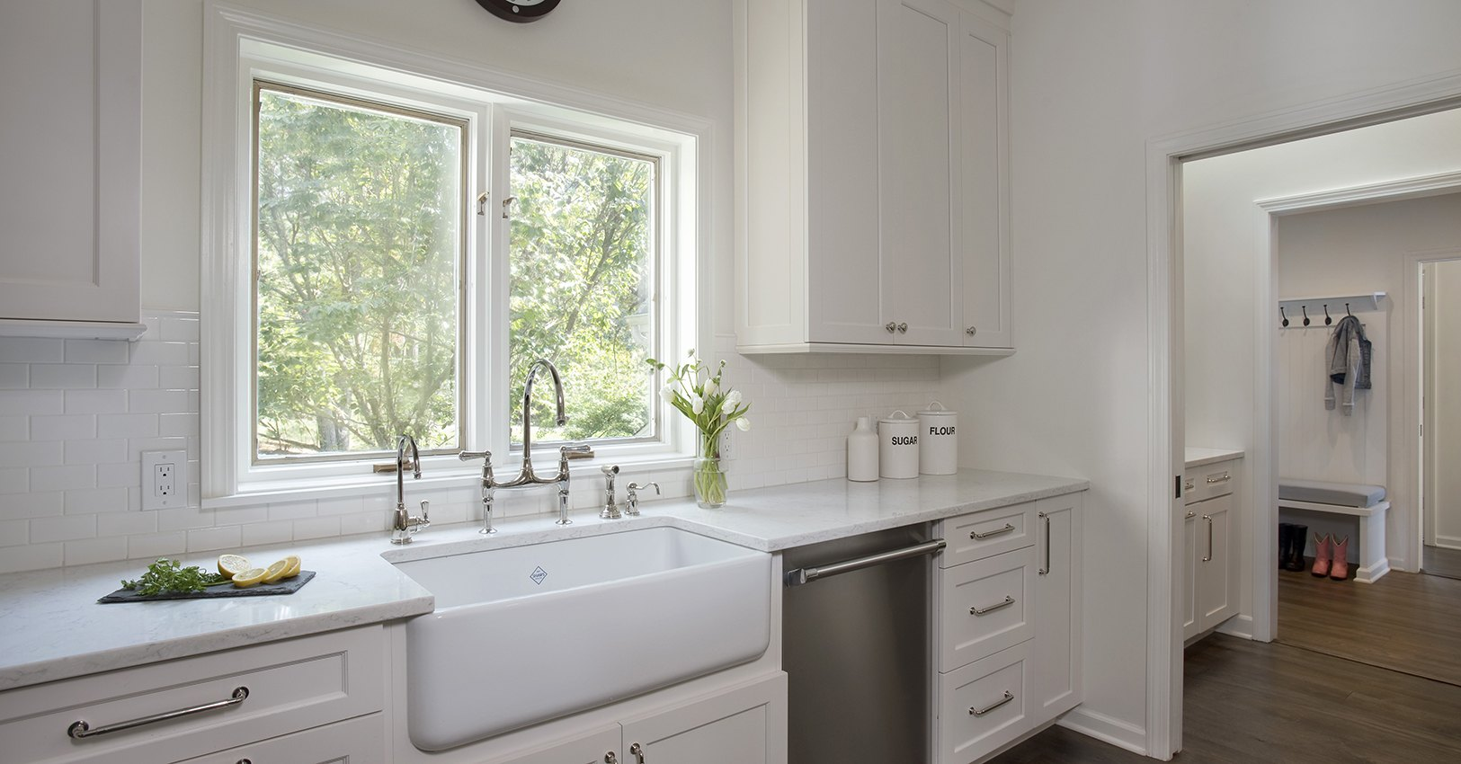 Rohl white farm sink grounds this sink elevation in this kitchen redesign