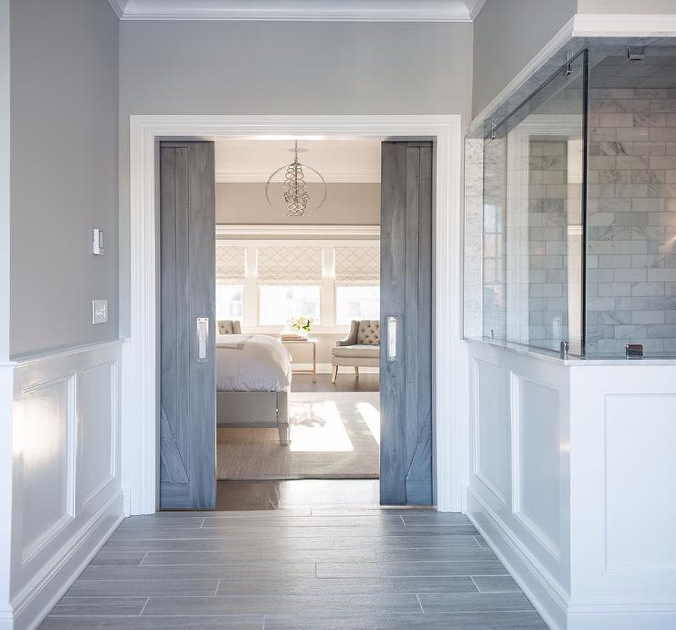 Wainscotting adds a traditional touch to this master bedroom suite