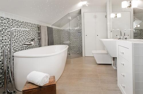 Modern Bath with white freestanding tub and mosaic tile