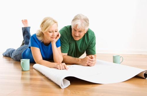 couple looking at remodeling plans