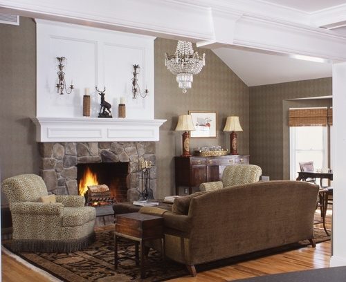 Wilton Connecticut living room with fireplace with glowing fire.