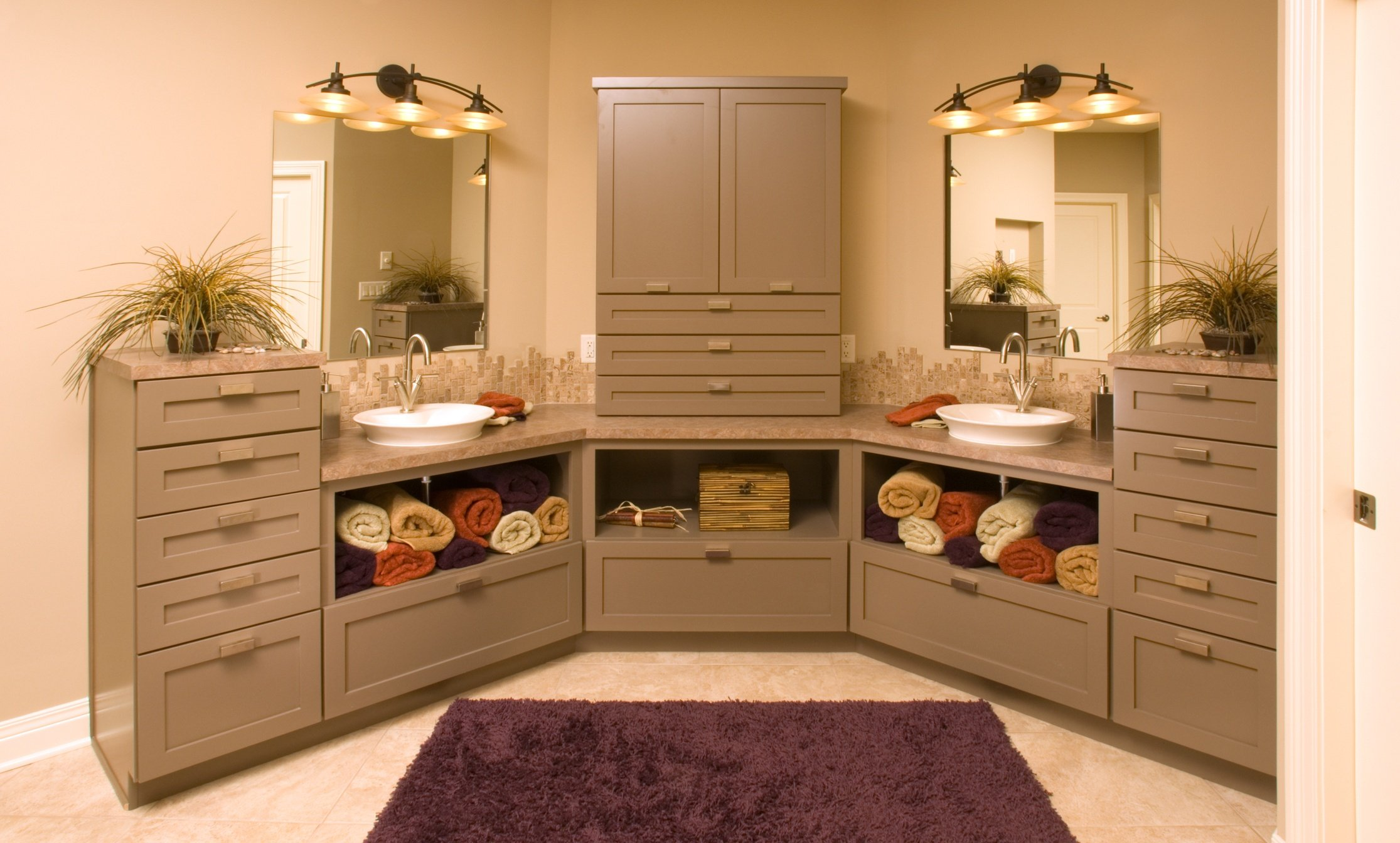 dual vanities with open shelves below in master bath remodel