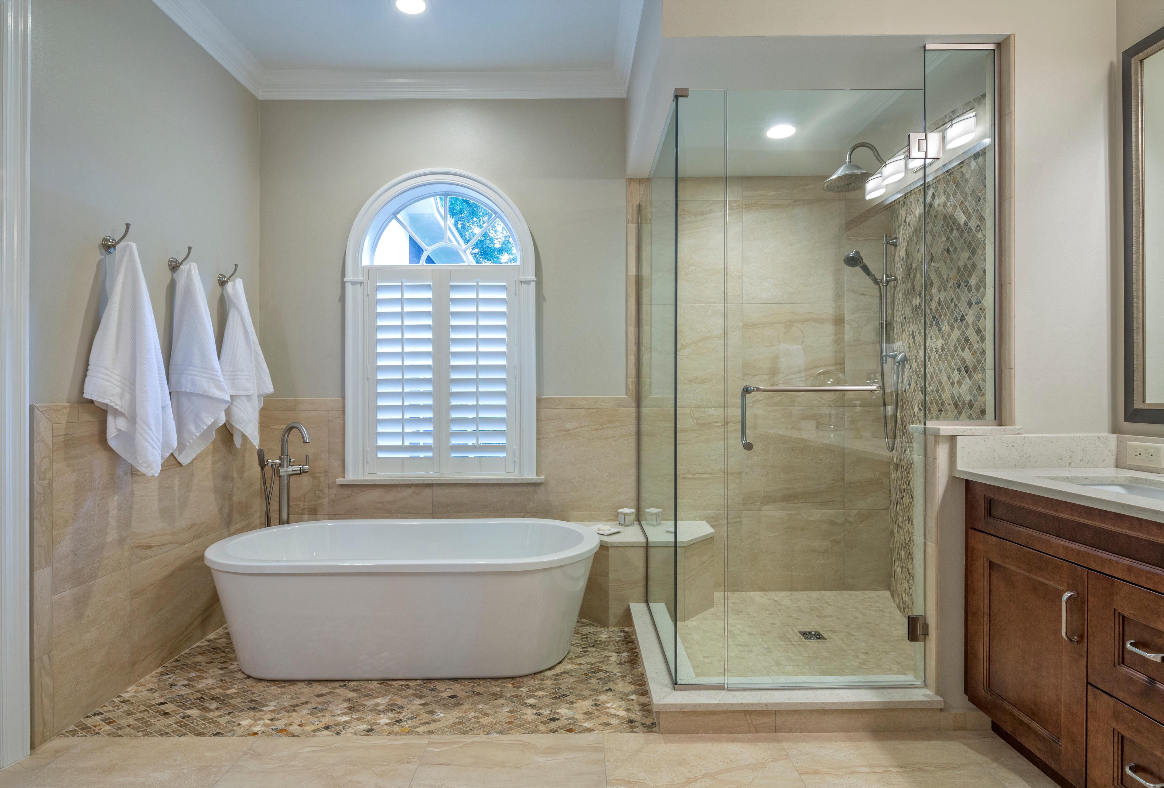 spacious master bath with freestanding white tub