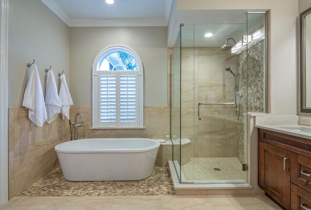 spacious master bath with freestanding white tub