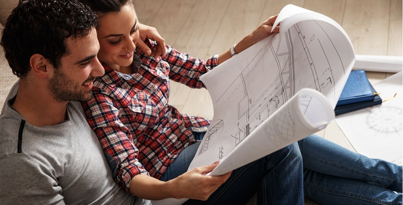 Couple reviews design build plans together and discusses benefits.