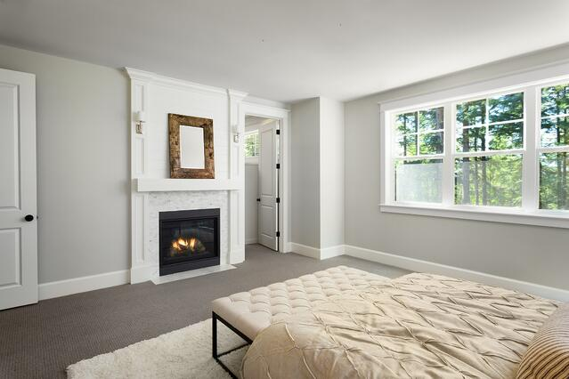 Fireplace adds warmth and character to this master suite addition
