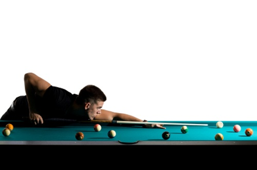 Man playing pool or billiards.
