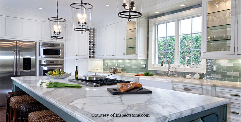 White cabinets with white marble counter from inspectstone.com