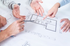 stock-photo-56593366-employees-discussing-project.jpg