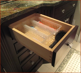 vanity drawer with accessories for toothbrushes and hair accessories