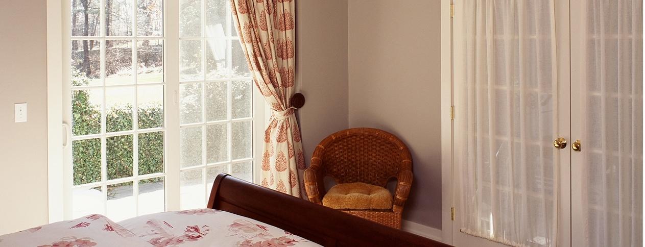 Guest bedroom in New Canaan Clark Construction design build renovation project.