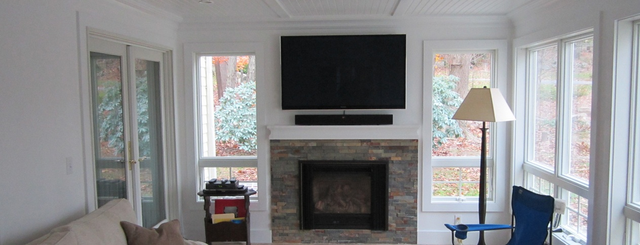 Clark Construction designed and built sun room with fireplace in Ridgefield, CT