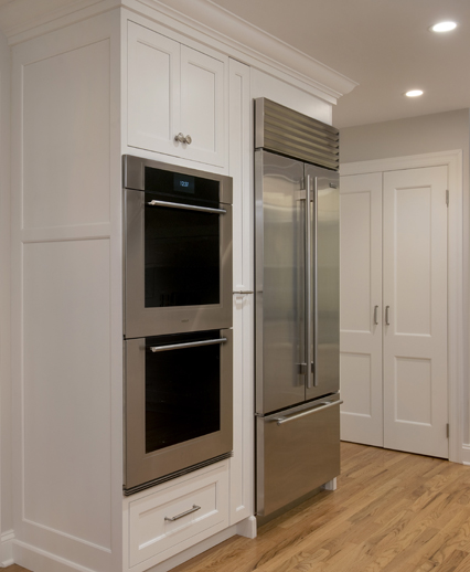 Double oven, refrigerator and spice pullout in this Wilton CT kitchen overhaul.