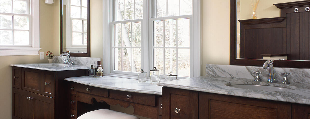 Master bath renovations include vanities with Carerra marble with lots of natural light, by Clark Construction in Wilton CT