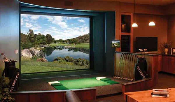Custom golf room built in basement with all the bells and whistles for the golf enthusiast.