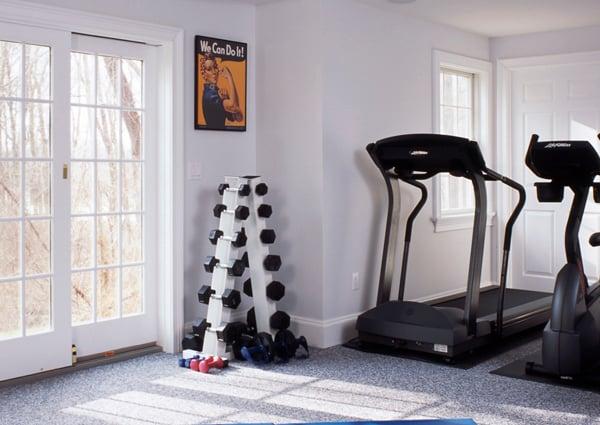 Custom designed home gym after basement renovation with Clark Construction.