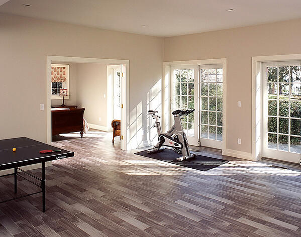 This basement renovation includes a gym and playroom, designed for the entire family