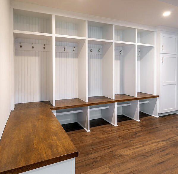 Custom built storage area in renovated basement by Clark Construction.