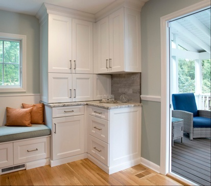 Corner cabinets and a banquette provide a lot of storage in Clark Construction's Wilton kitchen remodel.