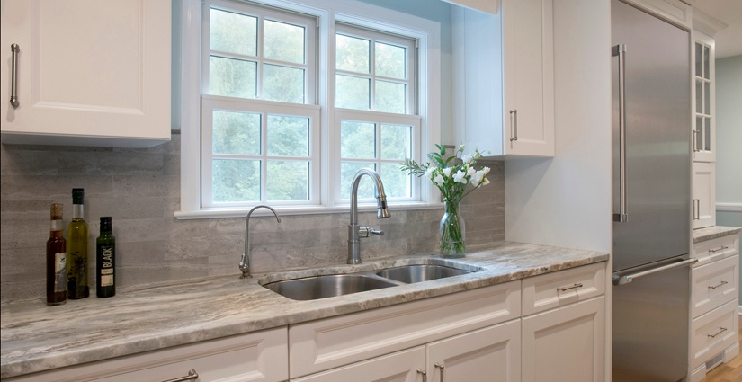 Natural light makes this double bowl sink with water filter faucet a nice place to work.