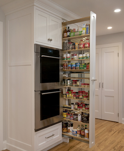 Full height spice pullout is the highlight of this bank of kitchen cabinets.