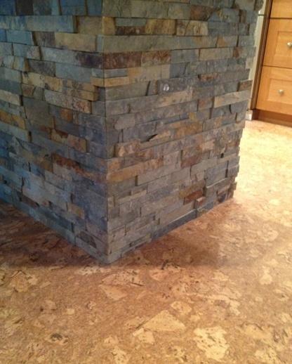 Cork floors and a stone island.