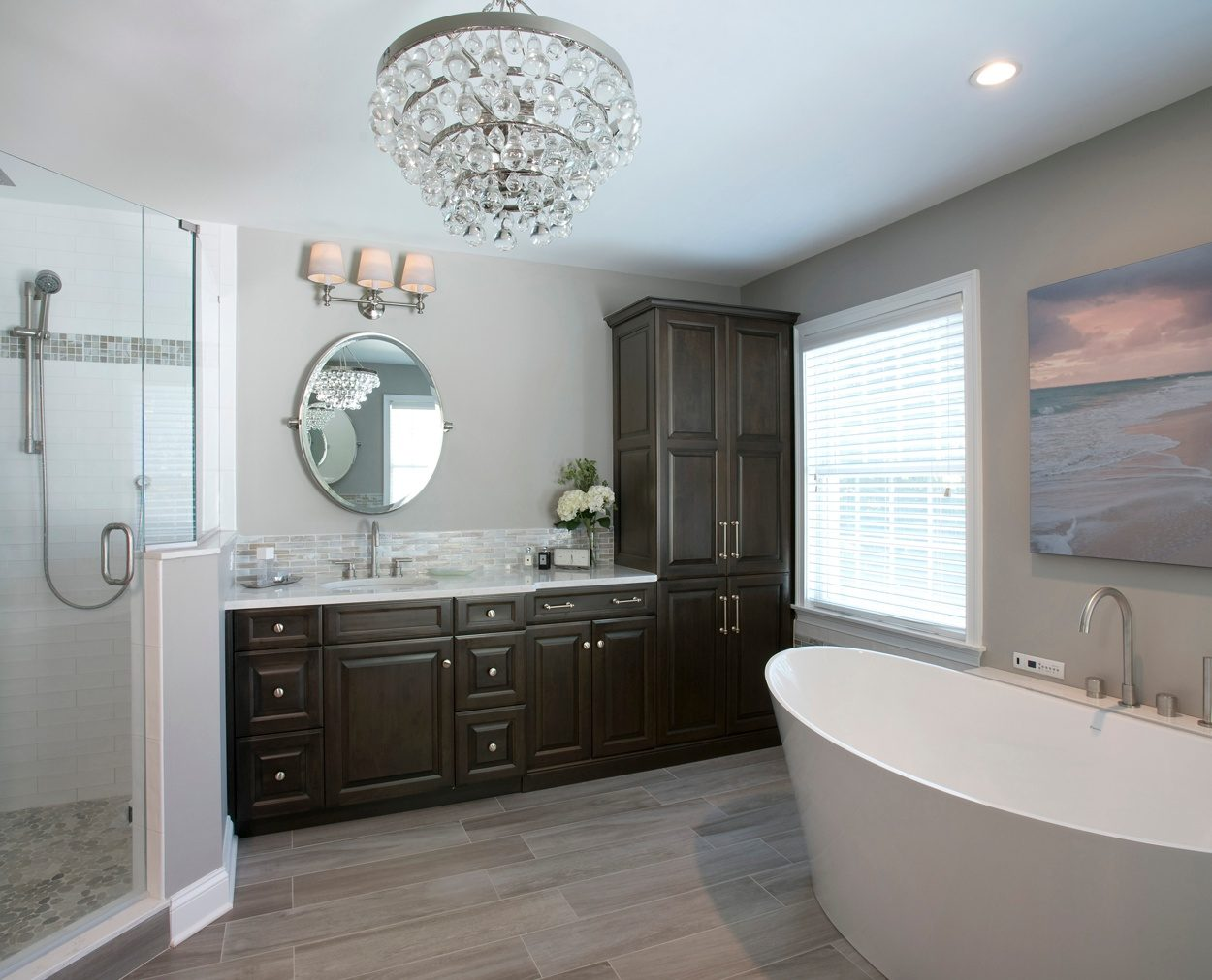Dark Grabill cabinetry and a big shower are highlights of this Clark Construction bath design.
