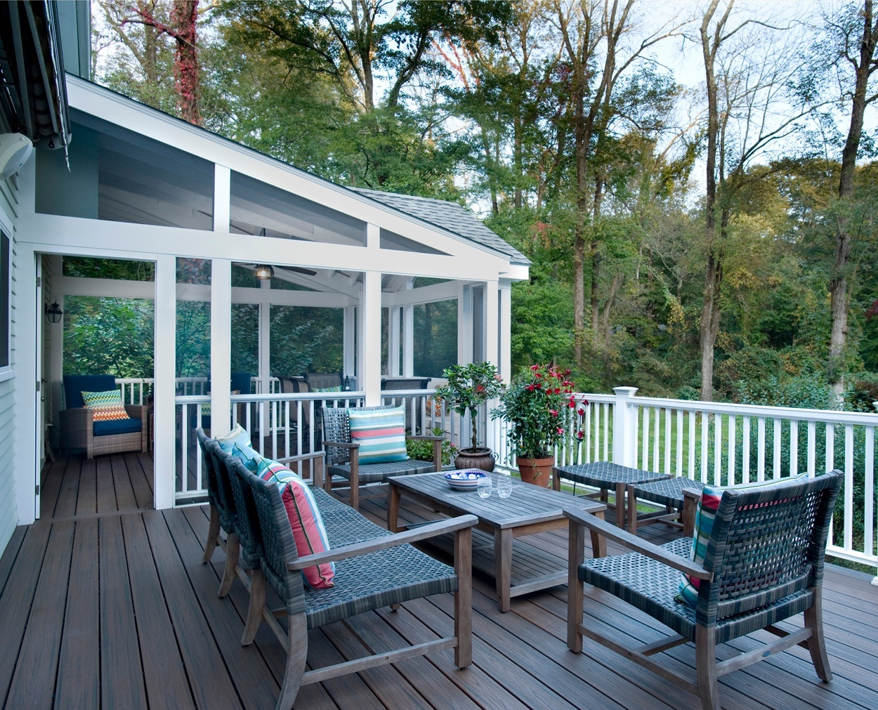 Colorful cushions add detail to outdoor furniture on a Trex deck.