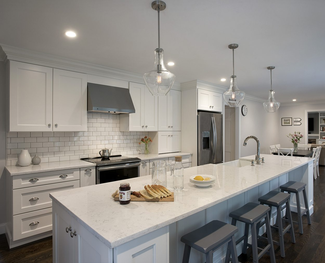 Kitchen design with white cabinets and a large island