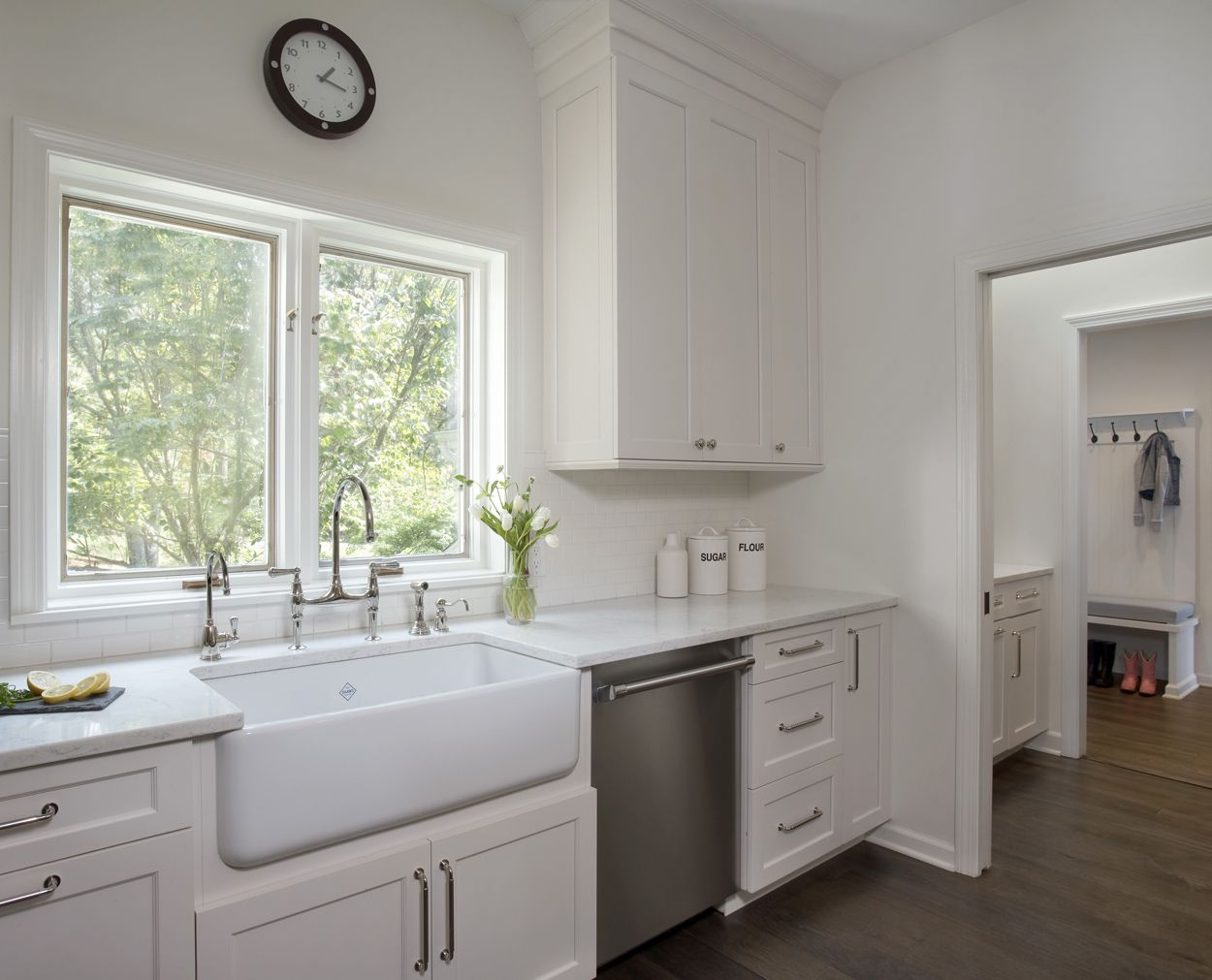 Rohl farm sink with a glimpse into the adjacent mudroom.