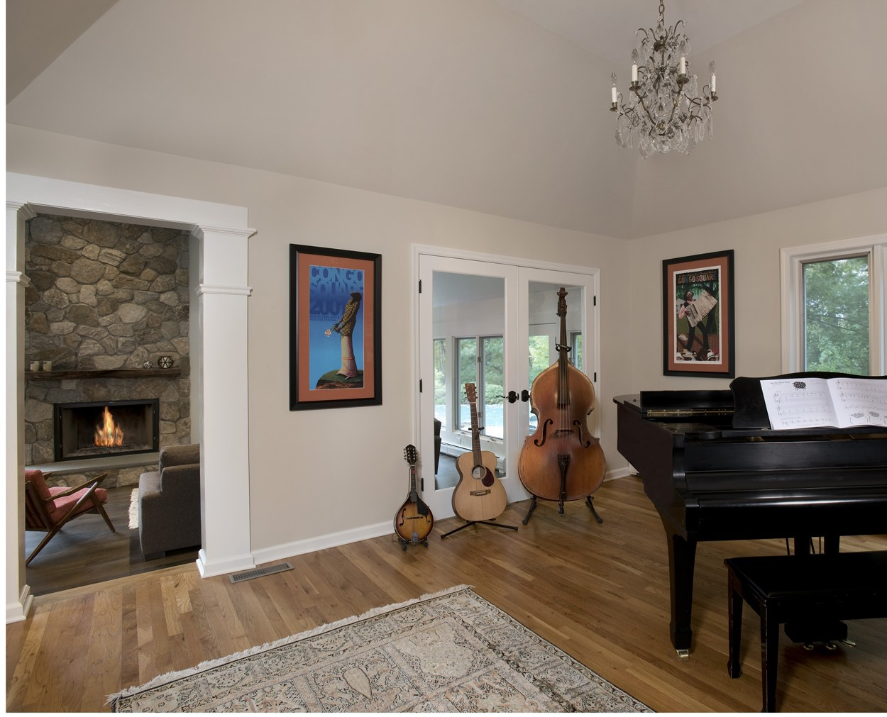 Fireplace is viewed through  a columned opening in this Ridgefield renovation.