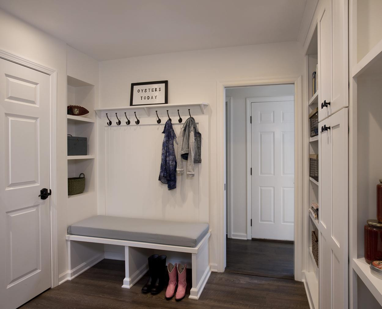 mudroom with pink boots