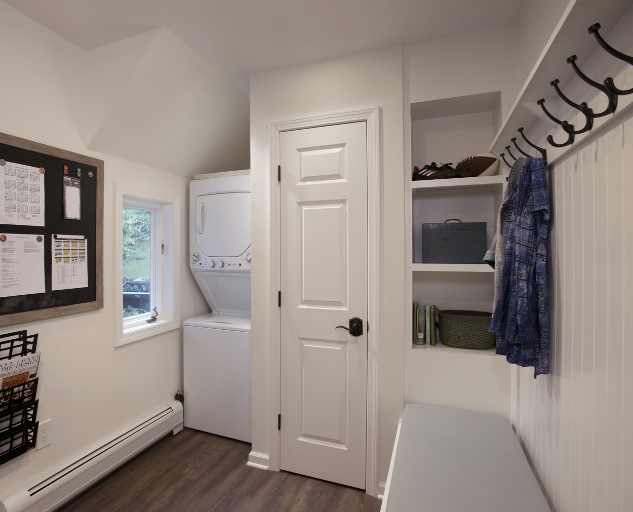 Mudroom with laundry center and built in storage helps clients stay organized.