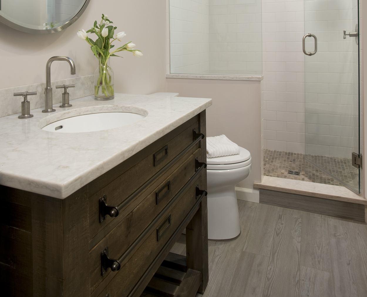 Restoration Hardware vanity and frameless shower door.