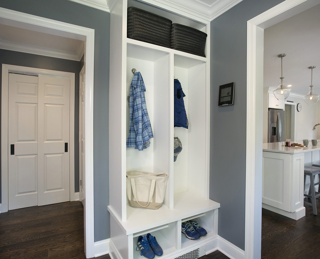 Mudroom and kitchen in Clark Construction's whole house remodel design