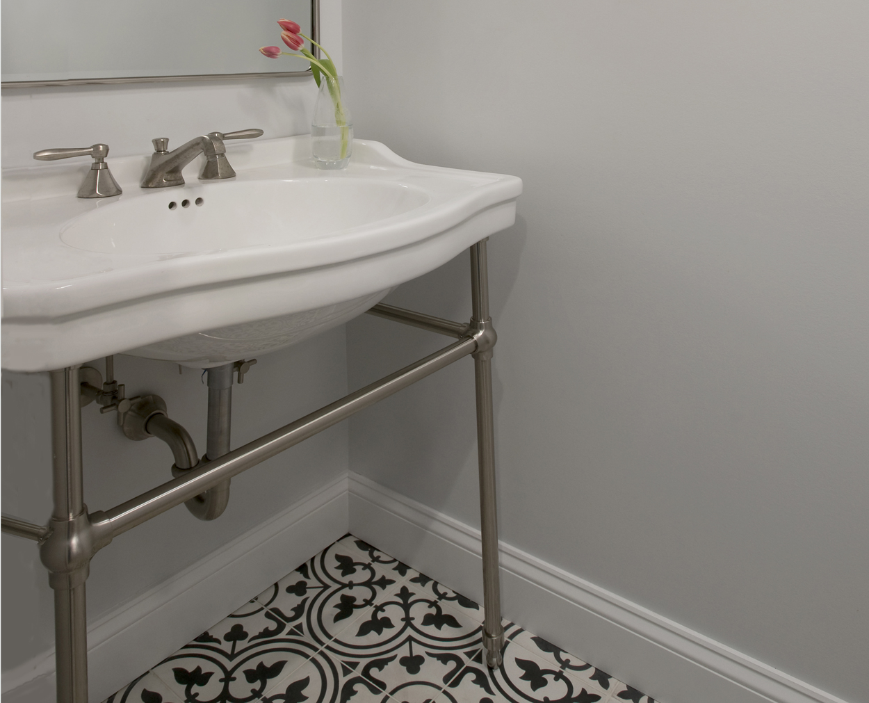 Powder room with concrete tile and freestanding vanity