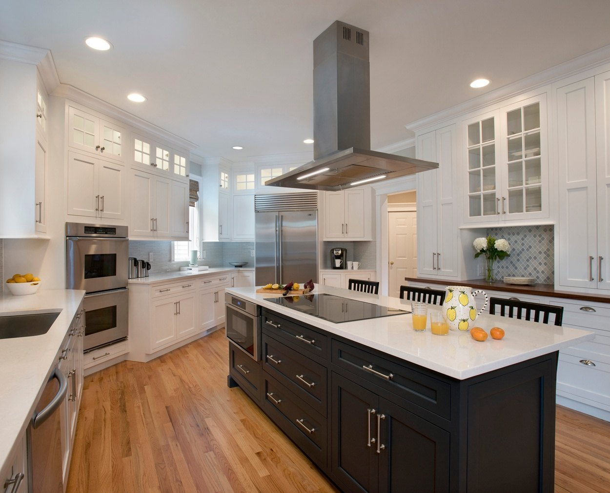Grabill cabinets in white peony with a dark painted island