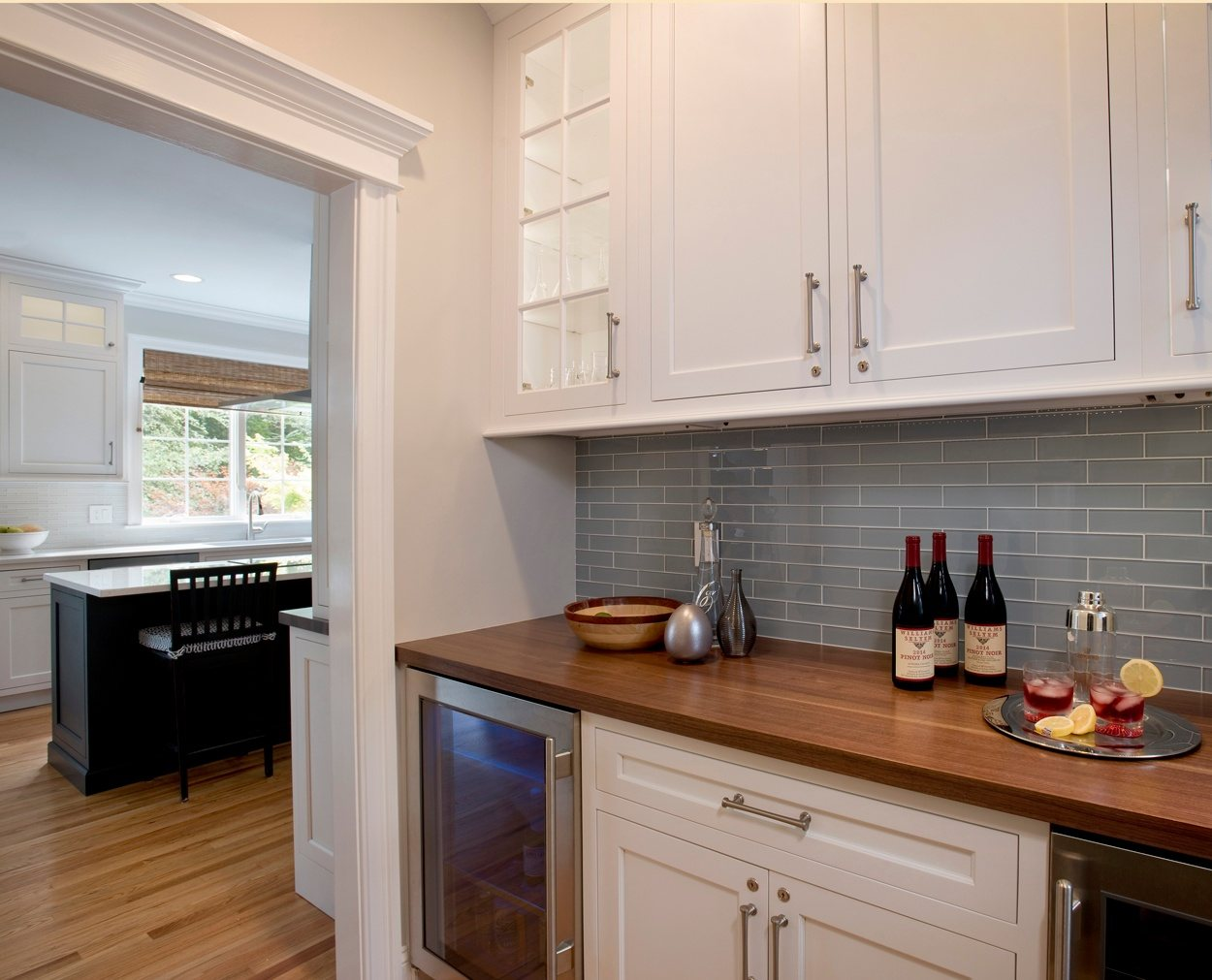 Butler's pantry and view into the kitchen for this classic kitchen design.