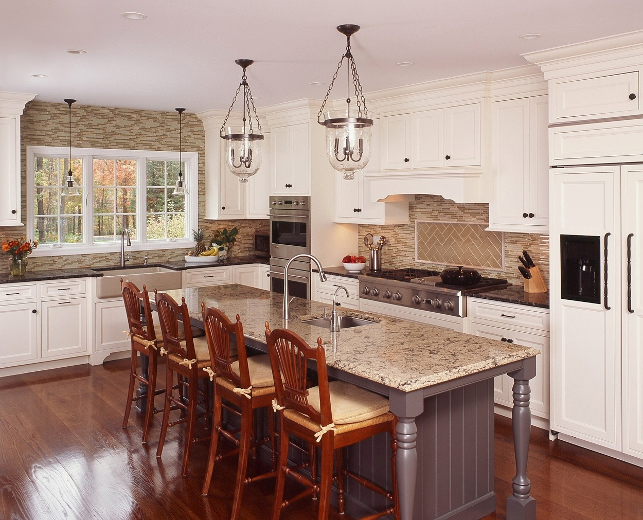 Center island, painted grey, anchors this Redding, CT kitchen.