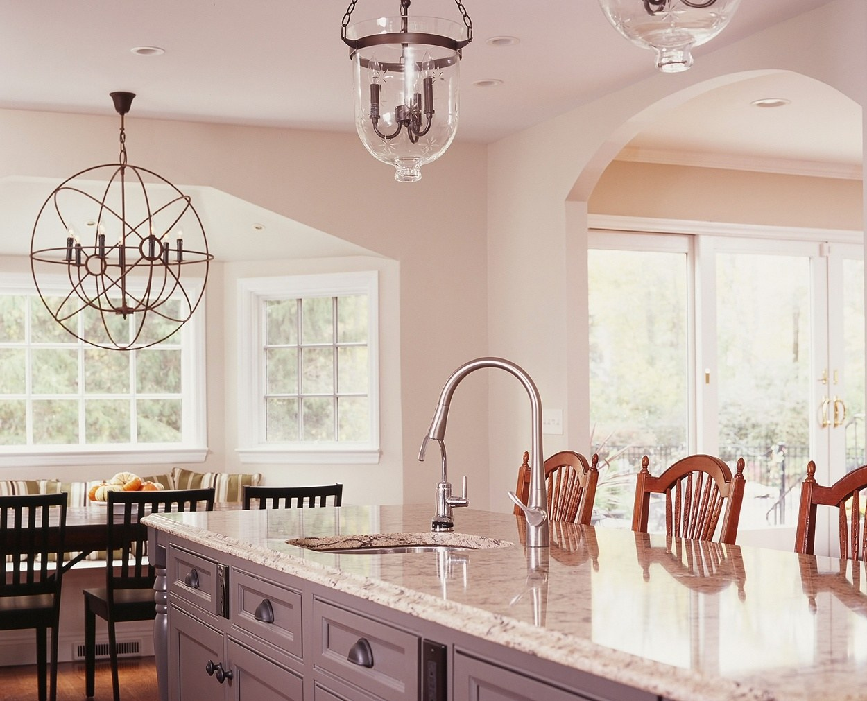 Center island features a prep sink and granite top.
