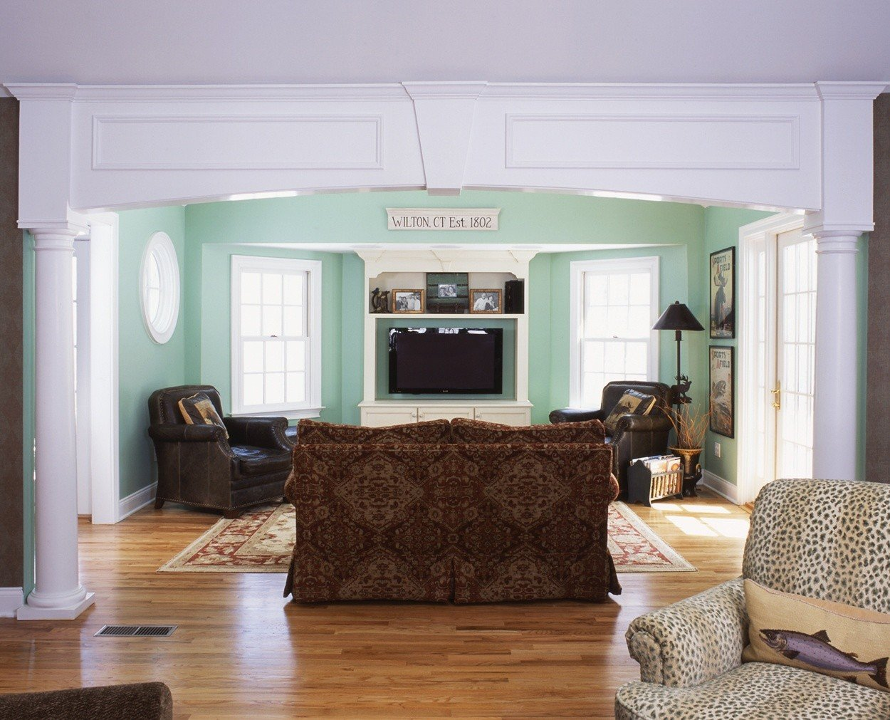 arched detailing and columns highlight the entrance to this media room