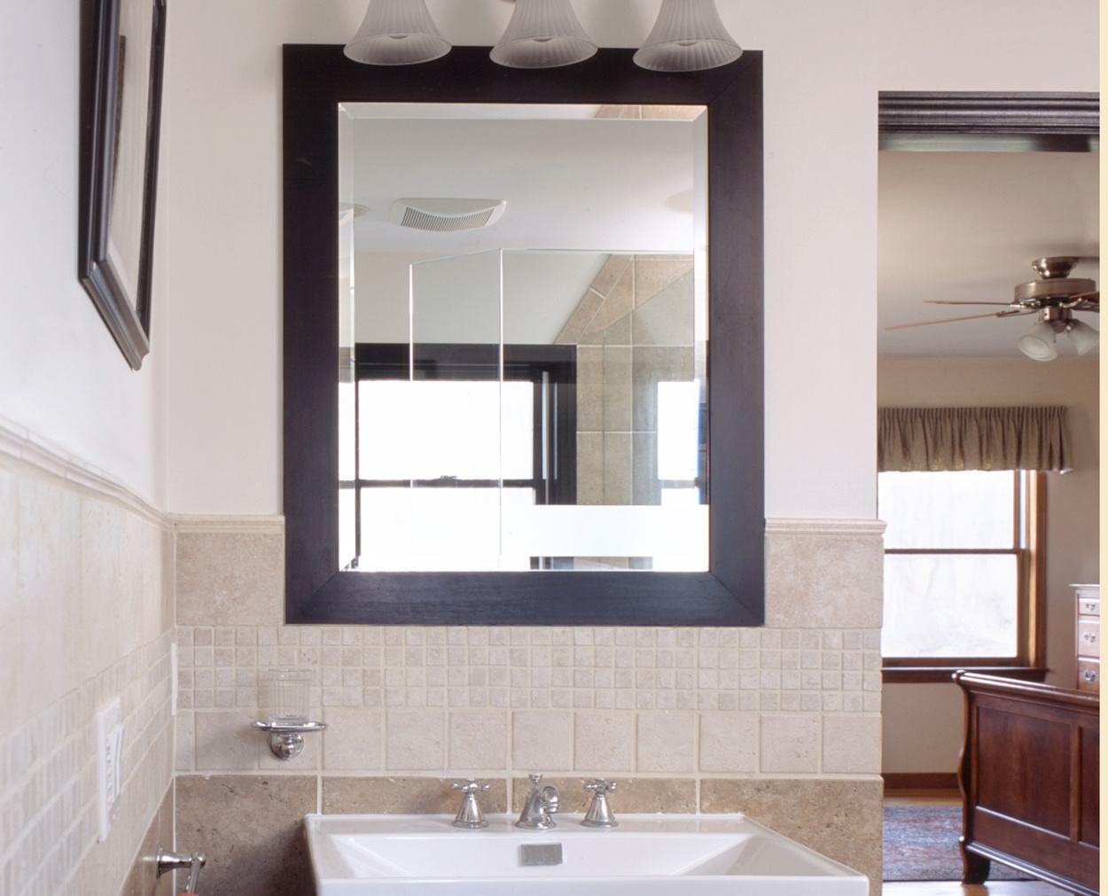 single vanity to the left of the door in master bedroom suite remodel.