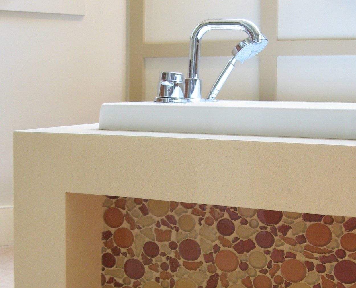 Detail of tub faucet on a modern bath.