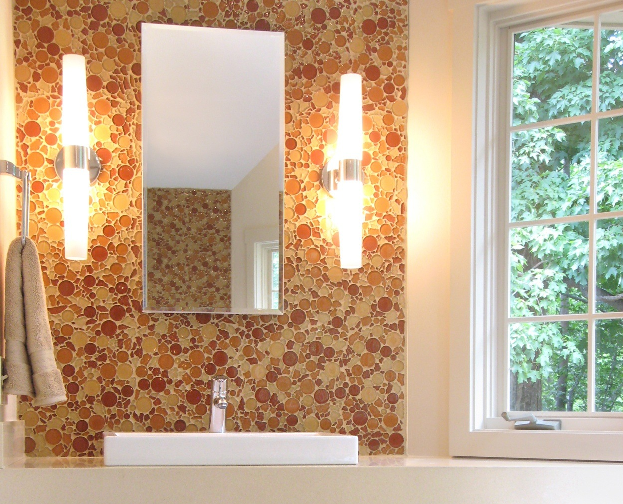 Circular glass tile and a cubed sink tops a custom vanity.