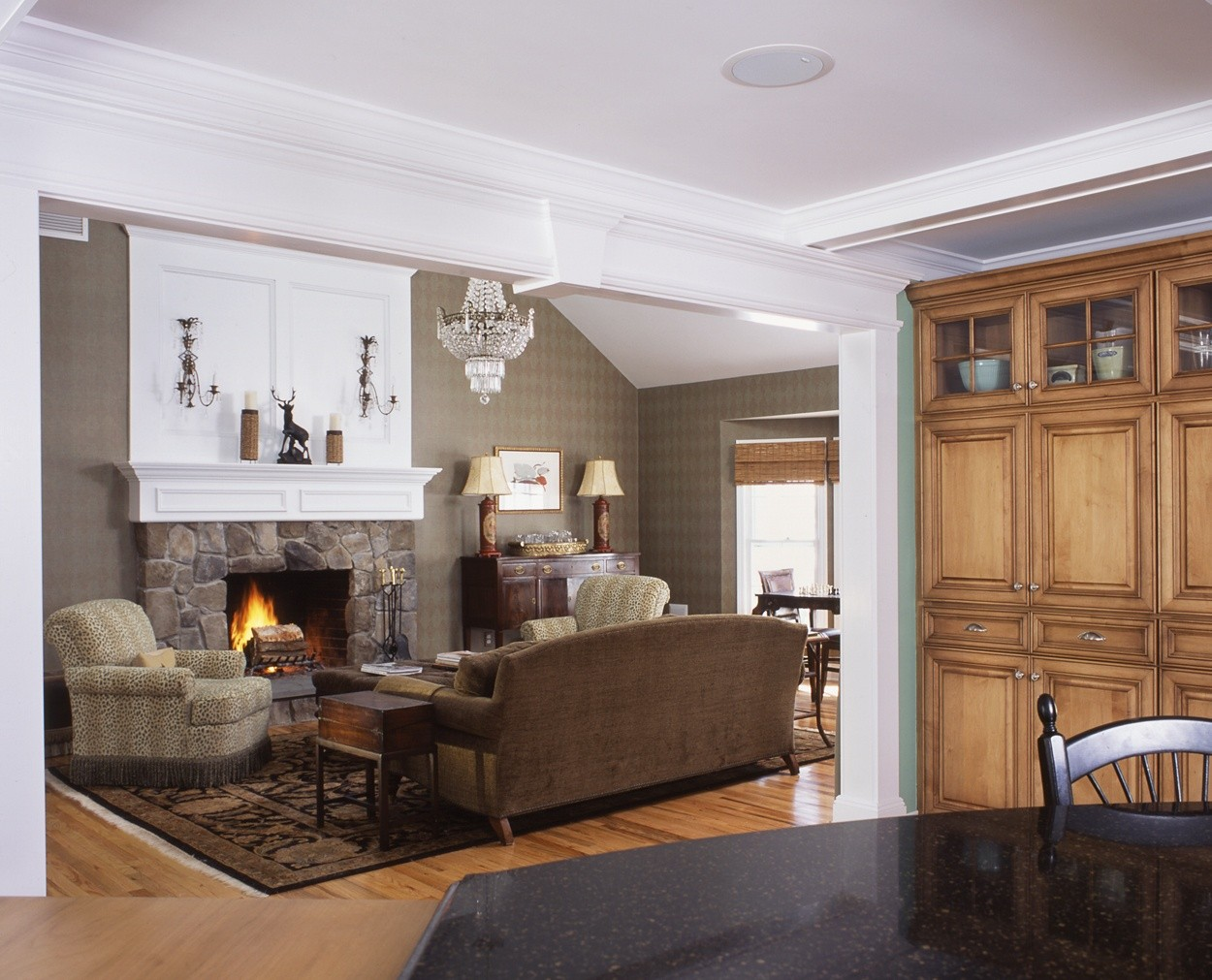 Stone fireplace surround gives this livingroom a warm feel.
