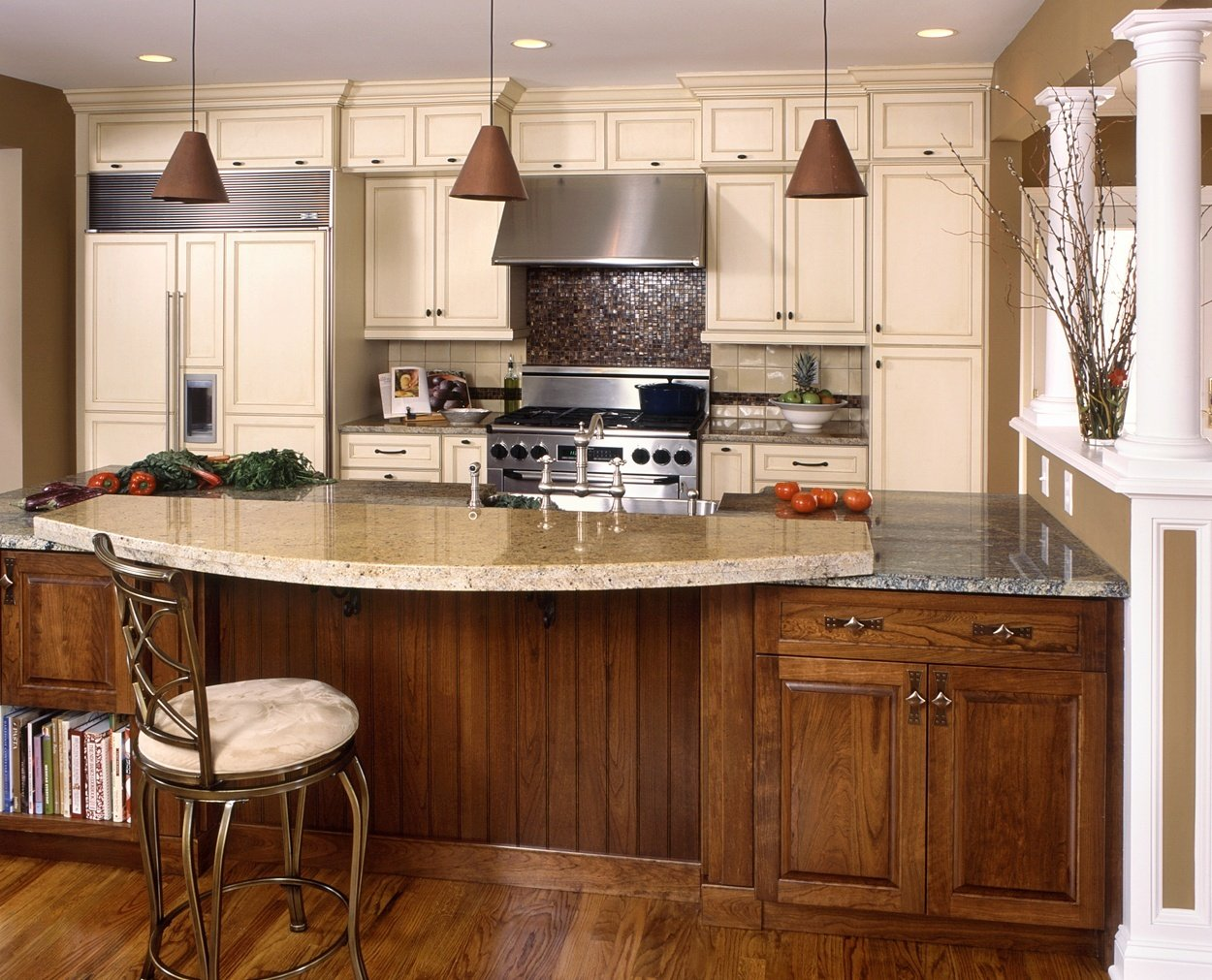 Bi level counter with glazed cabinets highlights this Clark Construction kitchen design.