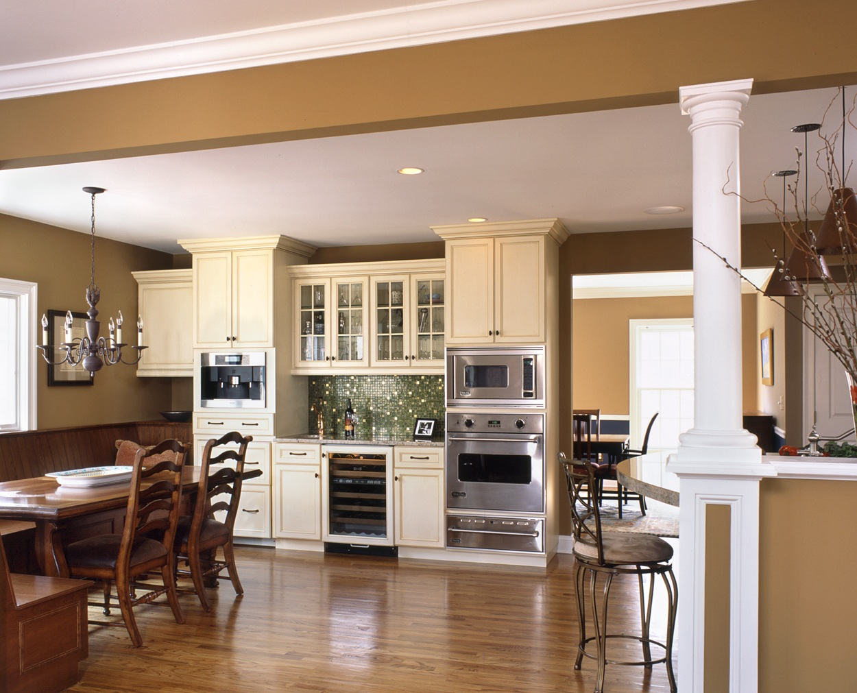 Breakfast bar and coffee area anchors this Clark Construction kitchen design.
